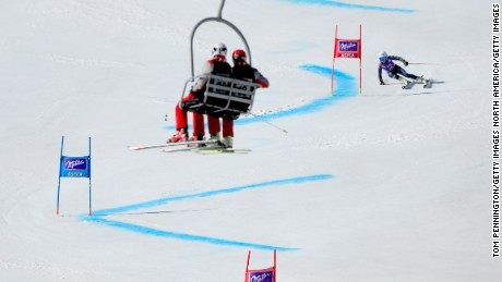 Laura Pirovano is watched by spectators in a chair lift.