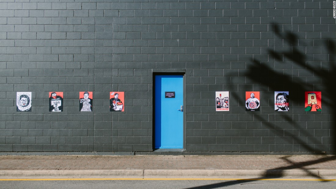 Badiucao's political cartoons seen outside the Praxis Artspace gallery in Adelaide, Australia in March 2017.