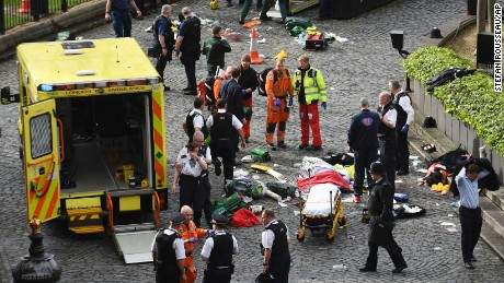 "Emergency services at the scene outside the Palace of Westminster, London, Wednesday, March 22, 2017.  London police say they are treating a gun and knife incident at Britain's Parliament ""as a terrorist incident until we know otherwise."" The Metropolitan Police says in a statement that the incident is ongoing. It is urging people to stay away from the area. Officials say a man with a knife attacked a police officer at Parliament and was shot by officers. Nearby, witnesses say a vehicle struck several people on the Westminster Bridge.  (Stefan Rousseau/PA via AP)."