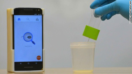 A disposable kit collects samples for insertion into the casing placed around the smartphone.