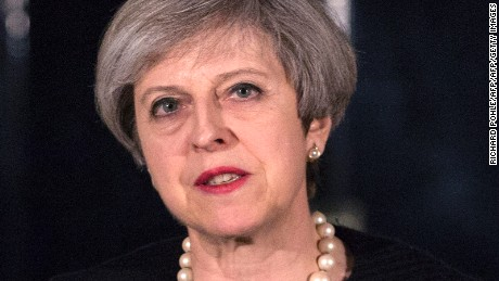 "British Prime Minister Theresa May speaks outside 10 Downing Street in central London on March 22, 2017, following the terror incident in Parliament earlier today. Britain will not change its terrorism threat level despite an attack in London on Wednesday which left three people and the assailant dead, Prime Minister Theresa May said. Three people were killed in a ""terrorist"" attack in the heart of London Wednesday when a man mowed down pedestrians on a bridge, then stabbed a police officer outside parliament before being shot dead. / AFP PHOTO / POOL / RICHARD POHLE        (Photo credit should read RICHARD POHLE/AFP/Getty Images)"