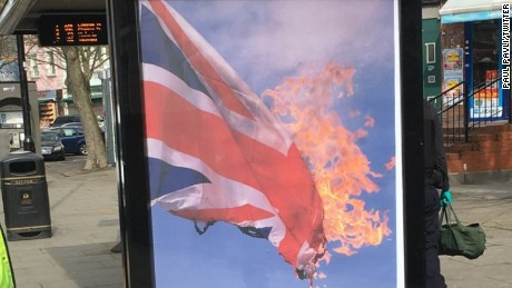 A poster showing a British flag on fire appeared at a bus station in London on Thursday.