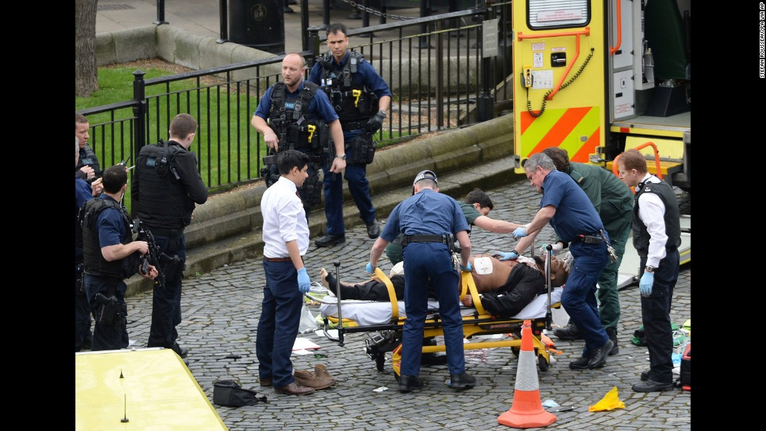 "Masood is treated by emergency services as police look on at the scene outside the Houses of Parliament. The Metropolitan Police say he was born in Kent, but is believed to have been living in the West Midlands recently. Police say Masood was also known by a number of aliases. ""Masood was not the subject of any current investigations and there was no prior intelligence about his intent to mount a terrorist attack,"" Met Police said in a statement."
