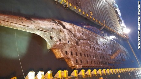 The Sewol ferry emerges from the water almost three years after it sank.