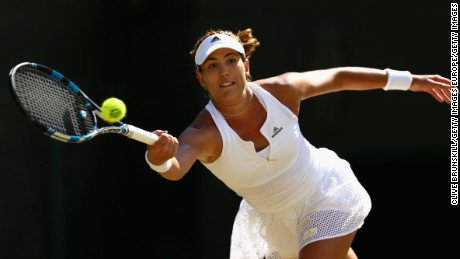 LONDON, ENGLAND - JULY 07:  Garbine Muguruza of Spain plays a forehand in her Ladies Singles Quarter Final match against Timea Bacsinszky of Switzerland during day eight of the Wimbledon Lawn Tennis Championships at the All England Lawn Tennis and Croquet Club on July 7, 2015 in London, England.  (Photo by Clive Brunskill/Getty Images)