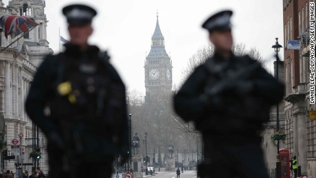 Armed police officers secure the area near the Houses of Parliament in central London on March 23, 2017 the day after the March 22 terror attack in Westminster claimed at least three lives including that of police officer Keith Palmer. 