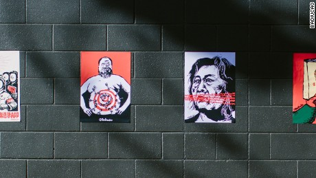 Cartoons of Ai Weiwei and jailed Chinese journalist Gao Yu outside Badiucao's Adelaide gallery show