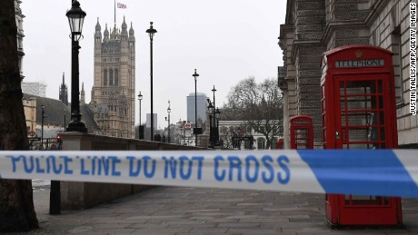 TOPSHOT - A police security cordon remains around the Houses of Parliament on March 23, 2017 in London.Seven people have been arrested including in London and Birmingham over Wednesday's terror attack at the British parliament, the police said on today, revising down the number of victims to three people. / AFP PHOTO / Justin TALLIS        (Photo credit should read JUSTIN TALLIS/AFP/Getty Images)