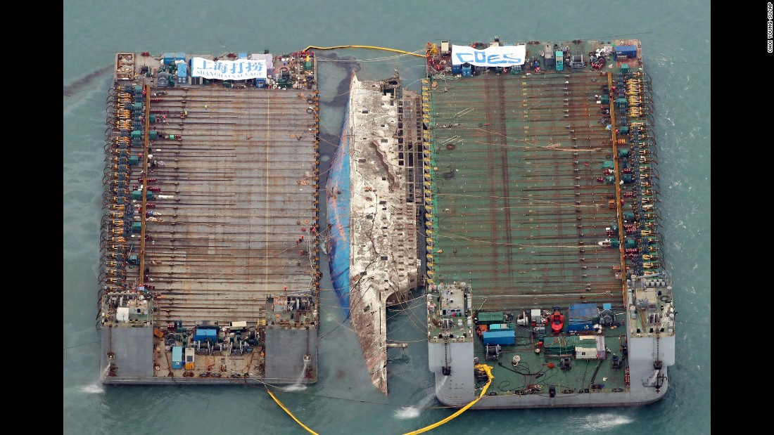 "Workers try to lift the sunken Sewol ferry between two barges during <a href=""http://www.cnn.com/2017/03/21/asia/south-korea-sewol-ferry/"" target=""_blank"">a salvage operation</a> near Jindo, South Korea, on Thursday, March 23. The Sewol sank on April 16, 2014, killing 304 people, mostly teens on a school trip. <a href=""http://www.cnn.com/2017/03/22/asia/south-korea-sewol-ferry/"" target=""_blank"">Nine bodies have yet to be recovered</a> since the ferry sank, and families and politicians have long called for the Sewol's recovery and a full investigation into its sinking."