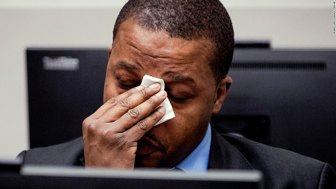 "Jean-Jacques Mangenda Kabongo of the Democratic Republic of the Congo, wipes his face during a verdict by the International Criminal Court in The Hague, Netherlands, on Wednesday, March 22. <a href=""https://www.icc-cpi.int//Pages/item.aspx?name=pr1287"" target=""_blank"">Kabongo and four others were found guilty</a> of various offenses against the administration of justice."