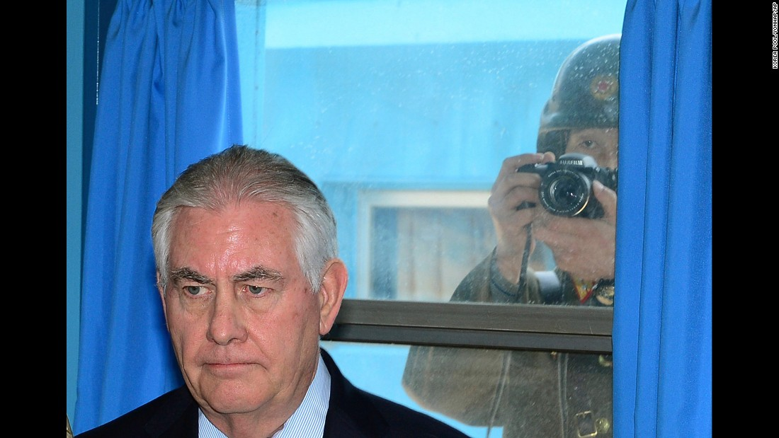 "A North Korean soldier tries to take a photograph through a window as US Secretary of State Rex Tillerson visits a UN meeting room at the border village of Panmunjom on Friday, March 17. <a href=""http://www.cnn.com/2017/03/17/politics/tillerson-south-korea-dmz/"" target=""_blank"">Tillerson visited the world's most heavily armed border</a>, greeting US soldiers near the tense buffer zone between North and South Korea."