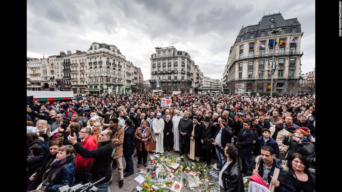 "People take part in a moment of silence at the Bourse in Brussels, Belgium, on Wednesday, March 22, to honor victims of last year's attacks. Wednesday marked one year since <a href=""http://www.cnn.com/2016/03/23/europe/brussels-belgium-attacks-what-we-know/index.html"" target=""_blank"">blasts shook Brussels Airport followed by explosions at a metro station in the city</a>; 32 people were killed and over 300 more were injured. ISIS later claimed responsibility for both. See related story: <a href=""http://www.cnn.com/2017/03/22/europe/brussels-attacks-one-year-on/"" target=""_blank"">She became the face of a terror attack; this is what happened next</a>"