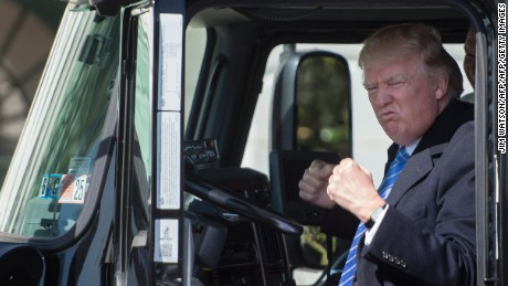 US President Donald Trump sits in the drivers seat of a semi-truck as he welcomes truckers and CEOs to the White House in Washington, DC, March 23, 2017, to discuss healthcare. / AFP PHOTO / JIM WATSON        (Photo credit should read JIM WATSON/AFP/Getty Images)
