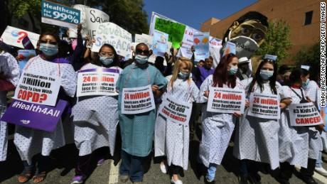 "Protesters dressed as hospital patients march towards the Federal Building during a ""Save the Affordable Care Act"" rally in Los Angeles, California on March 23, 2017.  The march coincides with the seventh anniversary of Obamacare.  / AFP PHOTO / Mark RALSTON        (Photo credit should read MARK RALSTON/AFP/Getty Images)"