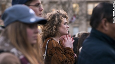 "Kit Keane, 19, is a politics student from Arlington, Virginia currently studying at Kings College. She attended the vigil held in Trafalgar Square on March 23, the day after the attack on Westminster. ""What happened yesterday really shook me. I'm in this city far from where I'm from,"" she says, emotion etched across her face.  ""No matter what your politics are, you can come together for something like this."" Taking a moment to compose herself, she continues: ""We're almost so desensitized to [violence]. I got up and went to school today without even thinking about it. I crossed the Thames on my way to school and didn't think about it twice."""