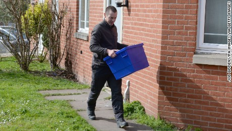 Police carry boxes this week from a Birmingham address in connection with the London attack.