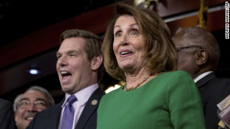 House Minority Leader Nancy Pelosi of Calif., right, accompanied by Rep. G. K. Butterfield, D-N.C., left, and Rep. Eric Swalwell, D-Calif., second from left, as they joke while speaking at a news conference on Capitol Hill in Washington, Friday, March 24, 2017. Republican leaders have abruptly pulled their troubled health care overhaul bill off the House floor, short of votes and eager to avoid a humiliating defeat for President Donald Trump and GOP leaders.(AP Photo/Andrew Harnik)