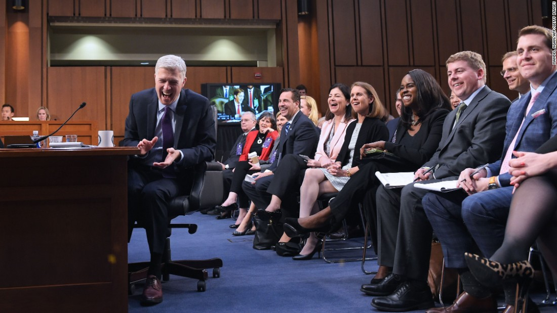 Neil Gorsuch, Supreme Court nominee, laughs at a senator's joke about his lack of bathroom breaks as he testifies before the Senate Judiciary Committee on Capitol Hill on Tuesday, March 21. Gorsuch is President Trump's pick to replace the late Justice Antonin Scalia.