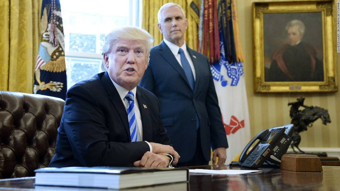 "President Donald Trump speaks to members of the media as Vice President Mike Pence looks on in the Oval Office on Friday, March 27, after Republicans were forced to pull a health care bill that aimed to repeal and replace Obamacare. ""We had no votes from the Democrats. They weren't going to give us a single vote, so it's a very very difficult thing to do,"" <a href=""http://www.cnn.com/2017/03/24/politics/donald-trump-health-care-blame/index.html"" target=""_blank"">Trump said</a>."