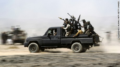 TOPSHOT - Armed Yemeni tribesmen loyal to the Shiite Huthi rebels sit in the back of an armed vehicle during a gathering to mobilise more fighters into several battlefronts on November 1, 2016 on the outskirts of the capital Sanaa.  The war in Yemen escalated in March 2015 when the Saudi-led coalition launched a military campaign to push back the Huthi rebels, after they seized the capital in 2014 and then advanced on other parts of Yemen.    / AFP / MOHAMMED HUWAIS        (Photo credit should read MOHAMMED HUWAIS/AFP/Getty Images)