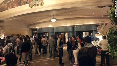 Guests wait outside of the Bellagio Hotel and Casino in the early hours of Saturday after a high- end jewelry store inside was burglarized.