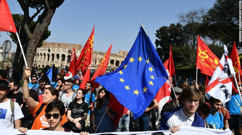 People take part in a pro-Europe demonstration Saturday near the Colosseum in Rome.