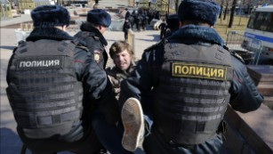 Police detain a protester in central Moscow on Sunday.