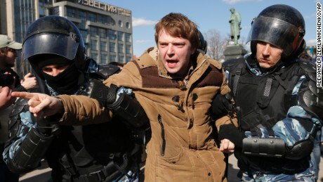 Police detain a protester in  Moscow on Sunday.
