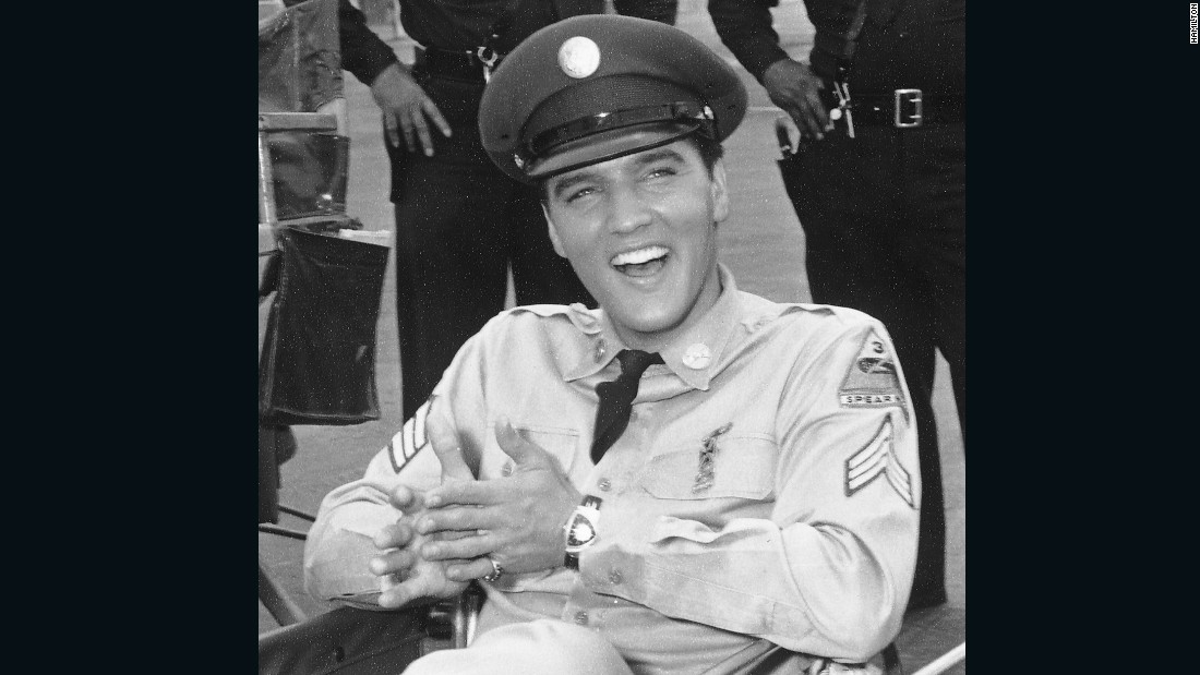 "Elvis Presley on the set of ""Blue Hawaii"" (1961) wearing his Hamilton Ventura. Presley insisted on wearing his own watch, endowing it with horological immortality. The Hamilton Ventura is now the basis of an entire collection within the brand's catalog and it is, indeed, referred to by the singer's name."
