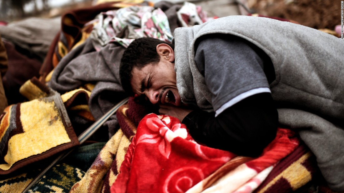 A man breaks down in tears while grieving for victims of a deadly airstrike in Mosul on March 17.