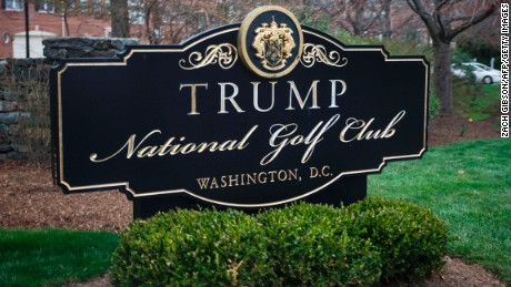 A sign for the Trump National Golf Club is pictured as President Donald Trump's motorcade arrives March 26, 2017 in Potomac Falls, VA.