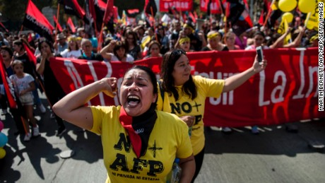 Thousands of workers march to protest against the Pension Fund Administration (AFP) in Santiago on March 26, 2017.  Demonstrations and marches were carried out in several Chilean cities  demanding the end of the current pension model.  / AFP PHOTO / Martin BERNETTI        (Photo credit should read MARTIN BERNETTI/AFP/Getty Images)