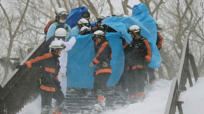 Firefighters carry a survivor from the site of an avalanche at Mount Nasu, Japan, on Monday.