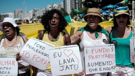 Demonstrators march along Copacabana Beach in Rio de Janeiro, Brazil, on March 26, 2017 during a nationwide protest against political corruption  / AFP PHOTO / Yasuyoshi Chiba        (Photo credit should read YASUYOSHI CHIBA/AFP/Getty Images)