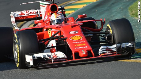 Ferrari's German driver Sebastian Vettel powers through a corner during the Formula One Australian Grand Prix in Melbourne on March 26, 2017. / AFP PHOTO / PAUL CROCK        (Photo credit should read PAUL CROCK/AFP/Getty Images)