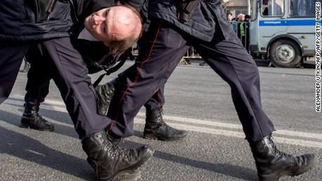 Police officers detain a man during an unauthorized anti-corruption rally in central Moscow on March 26.