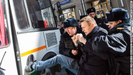 Officers detain Navalny during the Moscow protest.