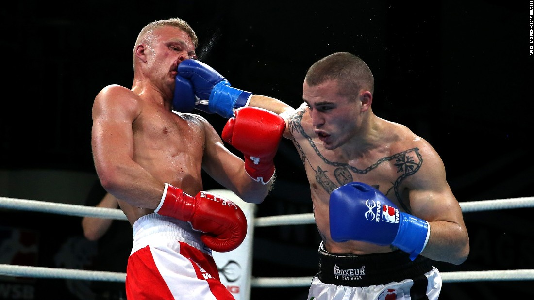 Callum French of British Lionhearts takes a hit from Michael Magnesi of Italia Thunder during the World Series of Boxing at York Hall on Thursday, March 23, in London.