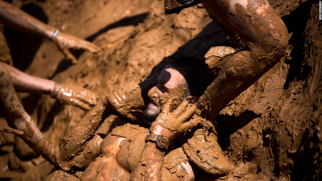 People take part in a Mud Day race, a roughly 8-mile obstacle course in Tel Aviv, Israel, on Friday, March 24.
