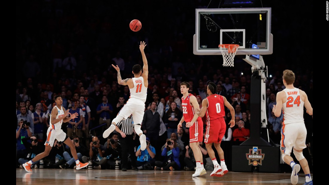"Florida guard Chris Chiozza, No. 11, puts up a last-second three-point shot to <a href=""http://bleacherreport.com/articles/2699941-florida-takes-the-win-vs-wisconsin-with"" target=""_blank"">score the game-winning points</a> against Wisconsin in overtime of an NCAA East Regional semifinal game, Saturday, March 25. Florida won 84-83."