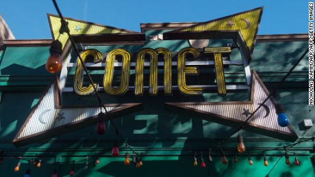 The sign for the Comet Ping Pong restaurant is seen in Washingon, DC, on December 5, 2016. An assault rifle-wielding gunman's appearance at a Washington pizzeria that was falsely reported to house a pedophile ring has elevated worries over the unrelenting rise of fake news and malicious gossip on the internet. No one was injured when 28-year-old Edgar Maddison Welch strode into the Comet Ping Pong restaurant, packed with families on a Sunday afternoon, and fired off a round from his AR-15.  / AFP / NICHOLAS KAMM        (Photo credit should read NICHOLAS KAMM/AFP/Getty Images)
