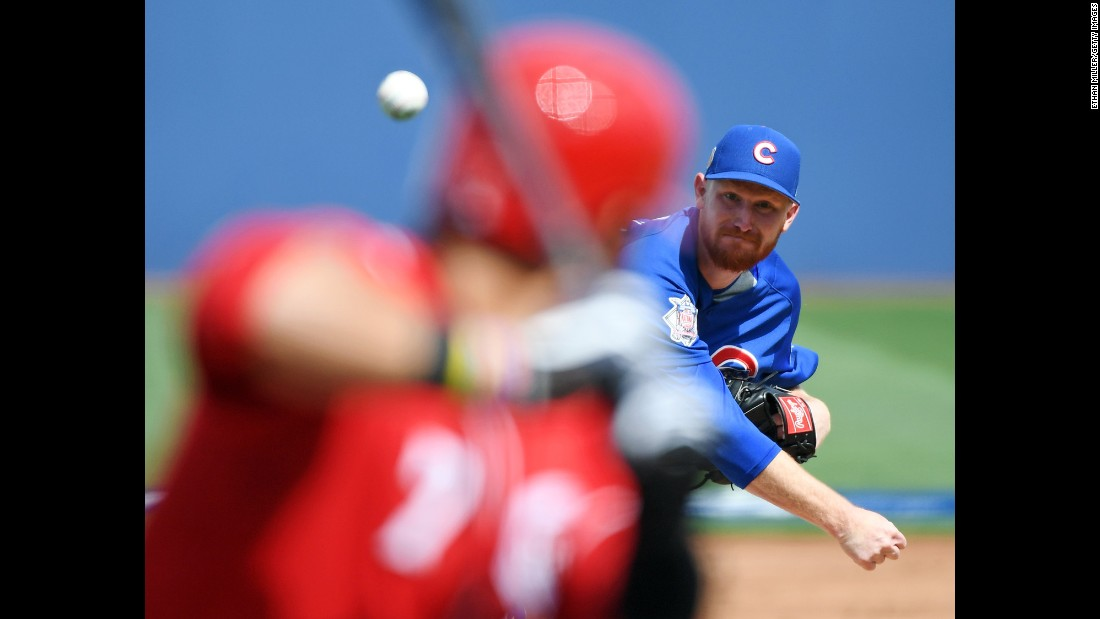Eddie Butler of the Chicago Cubs pitches against Eugenio Suarez of the Cincinnati Reds during an exhibition game on Saturday, March 26, in Las Vegas.