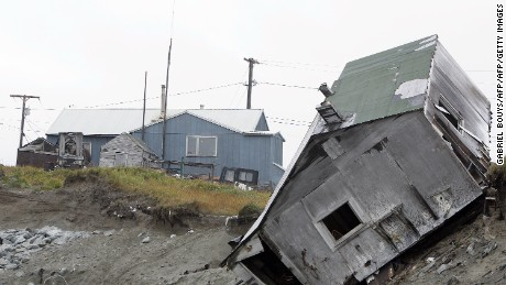 A house fell off the edge of the land in 2006. The Kokeok home is shown in the background.