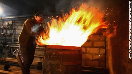 Charring the barrel -- flames are fired into whiskey barrels to char them, helping release flavor from the wood