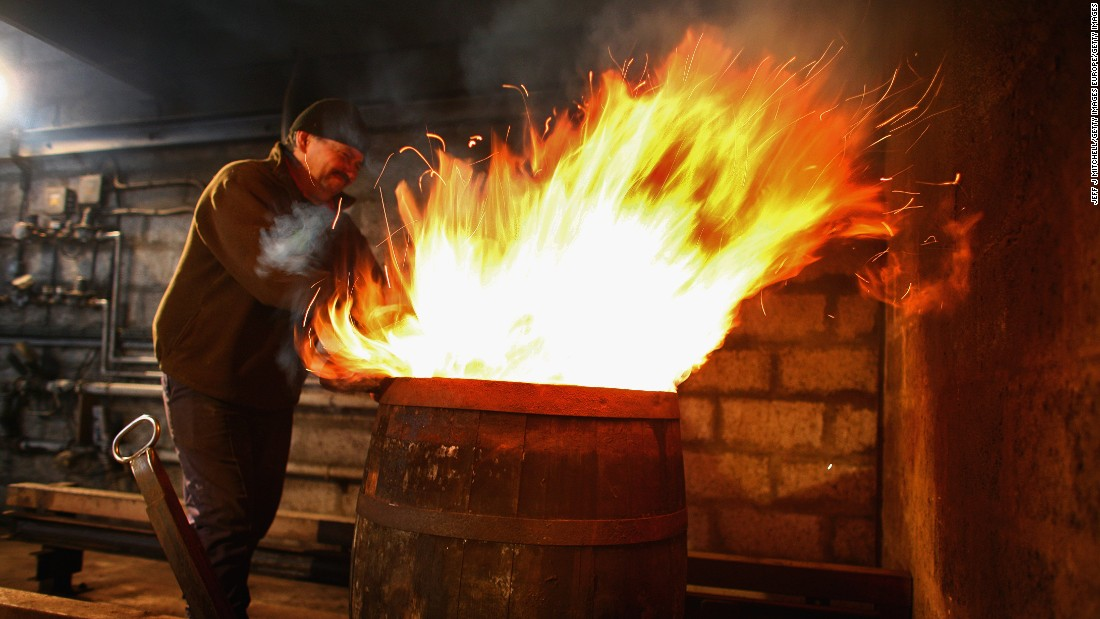 Flames are fired into whiskey barrels to char them, helping release flavor from the wood.<br />