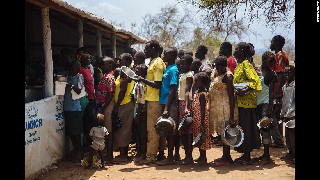 South Sudanese refugees line up for food at the Imvepi Reception Centre, Arua District, Northern Region, Uganda.