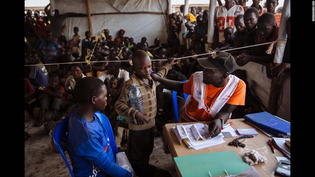 A UNHCR partner speaking with a South Sudanese refugee as he registers a family at the Imvepi Reception Centre, Arua District, Northern Region, Uganda.