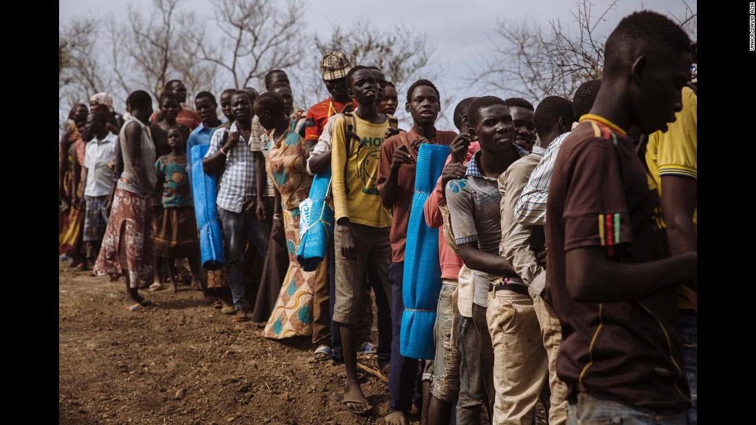 South Sudanese refugees queuing to be allocated plots at the recently established Imvepi settlement, Arua District, Northern Region, Uganda.