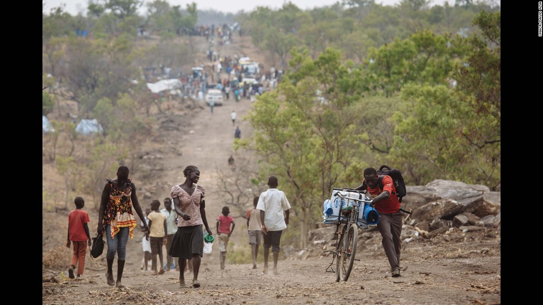 South Sudanese refugees walking down a road in Bidibidi refugee settlement, Yumbe District, Northern Region, Uganda.