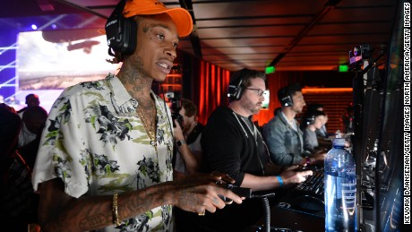 "LOS ANGELES, CA - JUNE 12: Rapper Wiz Khalifa plays the video game ""Battlefield 1"" after a Electronics Arts news conference on June 12, 2016 in Los Angeles, California. Thousands are expected to attend the annual three-day Electronic Entertainment Expo (E3) convention to see the latest games and announcements from the gaming industry. (Photo by Kevork Djansezian/Getty Images)"